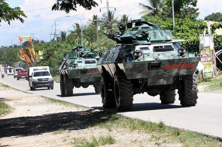 Armored vehicles patrol a highway on the southern Philippine island of Mindanao, on May 13, 2013