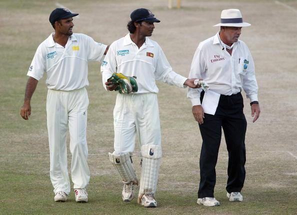 KANDY, SRI LANKA - DECEMBER 14:  Sri Lankan wicketkeeper Kumar Sangakkara is led away by Marvan Atapattu after a discussion with umpire Daryl Harper at the end of the fifth day of the second test between Sri Lanka and England at Asgiriya Stadium on December 14, 2003 in Kandy, Sri Lanka. (Photo by Stu Forster/Getty Images).