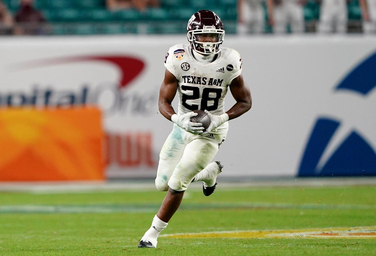 MIAMI GARDENS, FLORIDA - JANUARY 02: Isaiah Spiller #28 of the Texas A&M Aggies runs with the ball against the North Carolina Tar Heels during the first half of the Capital One Orange Bowl at Hard Rock Stadium on January 02, 2021 in Miami Gardens, Florida. (Photo by Mark Brown/Getty Images)