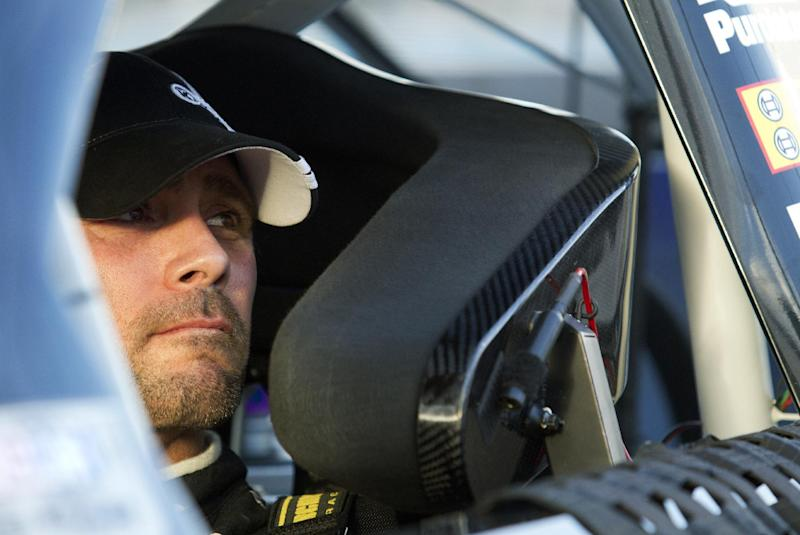 Jimmie Johnson looks out of his car following qualifying for the NASCAR Sprint Cup Series auto race, Friday, Nov. 9, 2012, at Phoenix International Raceway in Avondale, Ariz. (AP Photo/Paul Connors)