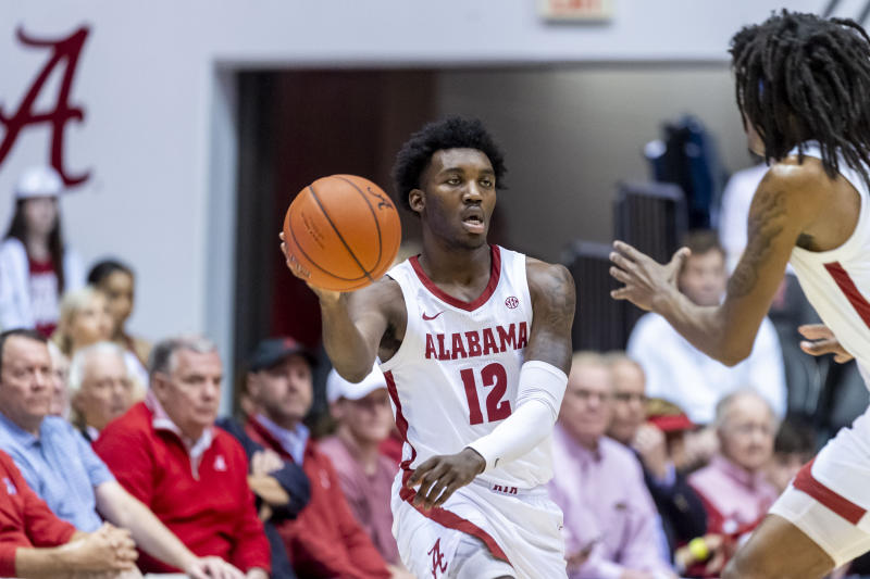 Alabama guard Jaylen Forbes (12) passes the ball during the first half of an NCAA college basketball game against Auburn, Wednesday, Jan. 15, 2020, in Tuscaloosa, Ala. (AP Photo/Vasha Hunt)