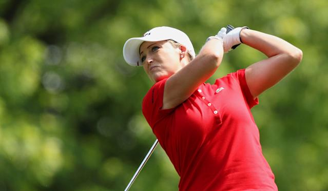 Cristie Kerr watches her tee shot on the 17th hole during second round play at the Canadian Pacific Women's Open golf tournament in London, Ontario, Friday, Aug. 22, 2014. (AP Photo/The Canadian Press, Dave Chidley)