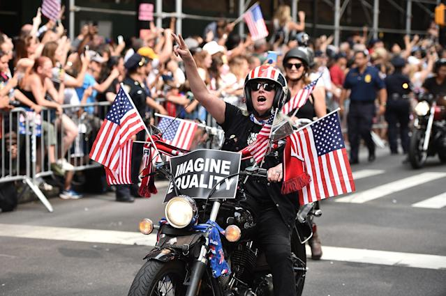 Fans celebrate during a Victory Ticker Tape Parade for the U.S. Women's National Soccer Team down the Canyon of Heroes on July 10, 2019 in the Manhattan borough of New York City. The USA defeated the Netherlands on Sunday to win the 2019 FIFA Women's World Cup France. (Photo by Theo Wargo/Getty Images)
