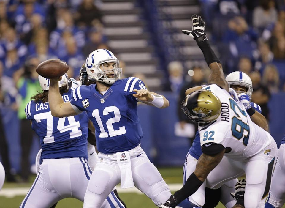 Indianapolis Colts quarterback Andrew Luck (12) throws as he is pressured by Jacksonville Jaguars defensive end Ziggy Hood (92) during the first half of an NFL football game Sunday, Nov. 23, 2014 in Indianapolis. (AP Photo/AJ Mast)