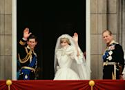 <p>Prince Philip looks happily out across the crowd as Prince Charles And Princess Diana Wave from the balcony of Buckingham Palace on their wedding day in 1981. </p>