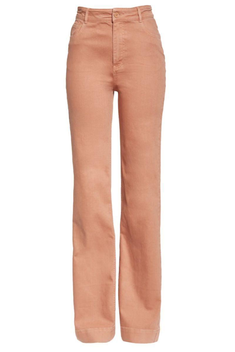 """<p><strong>ULLA JOHNSON</strong></p><p>nordstrom.com</p><p><a href=""""https://go.redirectingat.com?id=74968X1596630&url=https%3A%2F%2Fwww.nordstrom.com%2Fs%2Fulla-johnson-theo-flare-jeans-clay%2F5769194&sref=https%3A%2F%2Fwww.harpersbazaar.com%2Ffashion%2Ftrends%2Fg36864532%2Fnordstrom-anniversary-sale-2021-womens-clothing-deals%2F"""" rel=""""nofollow noopener"""" target=""""_blank"""" data-ylk=""""slk:Shop Now"""" class=""""link rapid-noclick-resp"""">Shop Now</a></p><p><del>$355.00</del> $213.00 <strong>(40% off)</strong></p><p>Bring out the '70s vibes in these high-waisted flared coral jeans. Keep it casual with your favorite T-shirt and sneakers. </p>"""