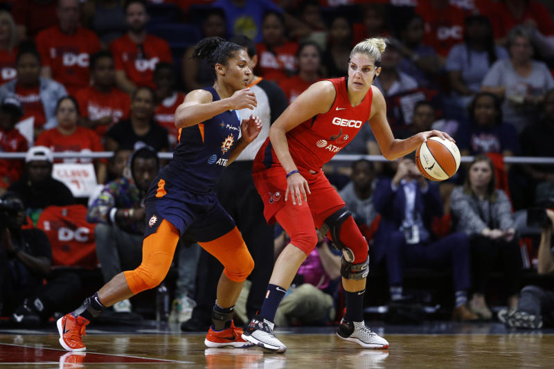 Washington Mystics forward Elena Delle Donne, right, drives against Connecticut Sun forward Alyssa Thomas in the first half of Game 1 of basketball's WNBA Finals, Sunday, Sept. 29, 2019, in Washington. (AP Photo/Patrick Semansky)