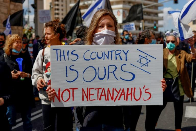 Anti-Netanyahu protesters say the veteran prime minister who earlier this month formed a new government with former rival Benny Gantz is hijacking democracy and should resign (AFP Photo/Emmanuel DUNAND)