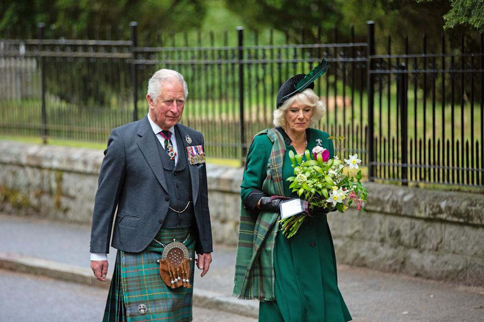 CRATHIE, SCOTLAND - MAY 8: In this picture released by Clarence House,  Prince Charles, Prince of Wales and Camilla, Duchess of Cornwall (known as the Duke and Duchess of Rothesay when in Scotland) walk to take part in a two minute silence to mark the 75th anniversary of VE Day at the Balmoral War Memorial on May 8, 2020 near Crathie, United Kingdom.   During the event the Prince of Wales laid a wreath and the Duchess of Cornwall placed flowers at the memorial. The UK commemorates the 75th Anniversary of Victory in Europe Day (VE Day) with a pared-back rota of events due to the coronavirus lockdown. On May 8th, 1945 the Allied Forces of World War II celebrated the formal acceptance of surrender of Nazi Germany.   (Photo by Amy Muir/WPA Pool/Getty Images)