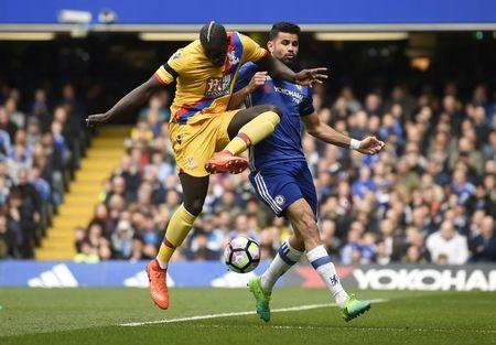 Crystal Palace's Mamadou Sakho in action with Chelsea's Diego Costa