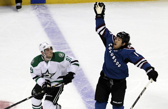 Dallas Stars center Tyler Seguin (91) watches as Colorado Avalanche right wing Steve Downie (17) catches the puck during the first period of an NHL hockey game in Denver on Tuesday, Oct. 15, 2013. (AP Photo/Joe Mahoney)