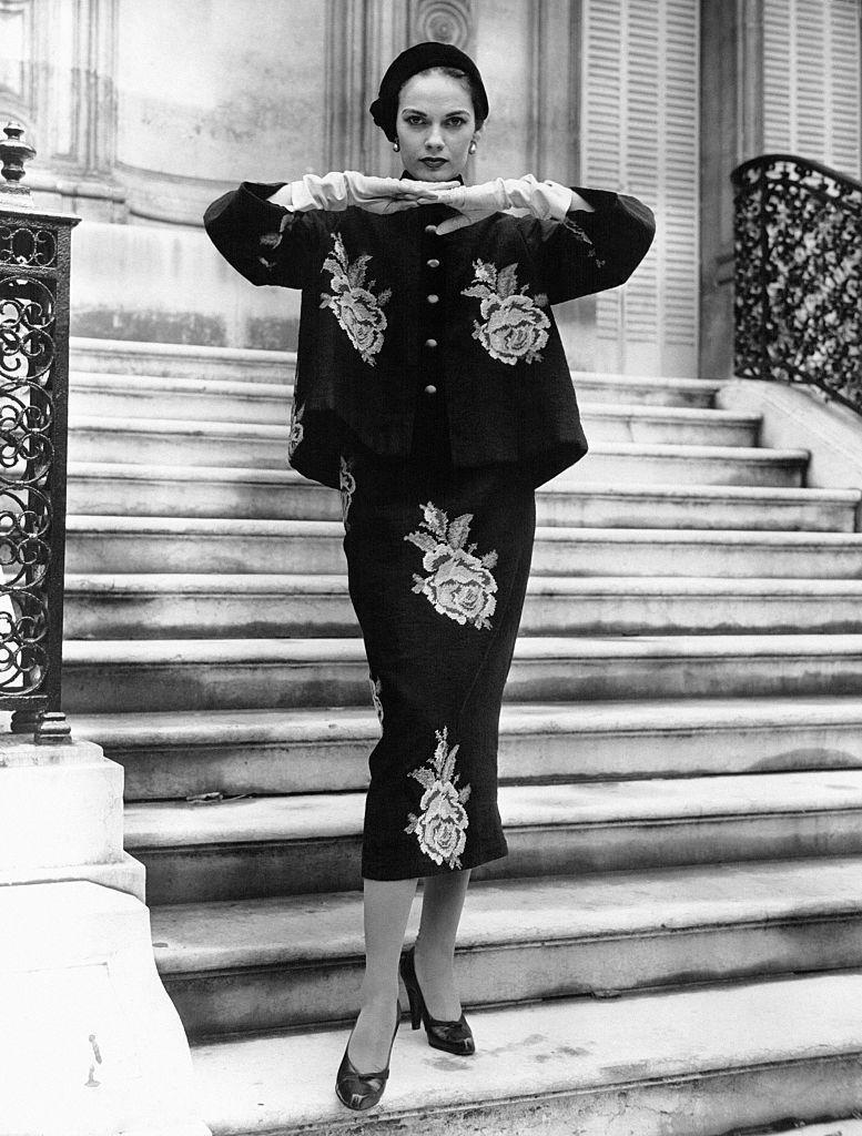 <p>A model wearing a needlepoint rose-print ensemble from the house of Hubert de Givenchy. </p>