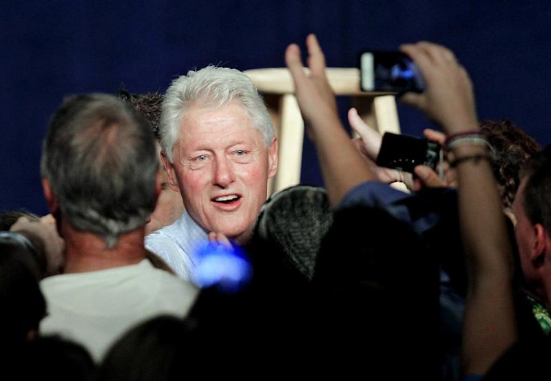 Former President Bill Clinton greets supporters during a campaign event for President Barack Obama, Thursday, Oct. 18, 2012, in Parma, Ohio. (AP Photo/Tony Dejak)