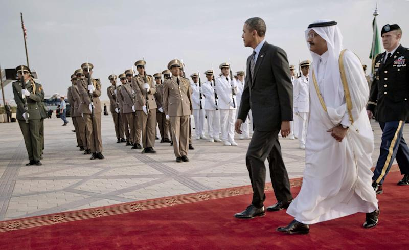 President Barack Obama walks past an honor guard during the arrival ceremony at King Khalid International airport in Riyadh, Saudi Arabia, Friday, March 28, 2014. President Barack Obama is in Saudi Arabia to reassure the key Gulf ally that his commitment to the Arab world isn't wavering. (AP Photo/Pablo Martinez Monsivais)