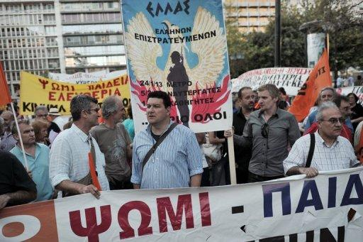 Protesters at an anti-austerity demonstration in central Athens on May 31, 2013