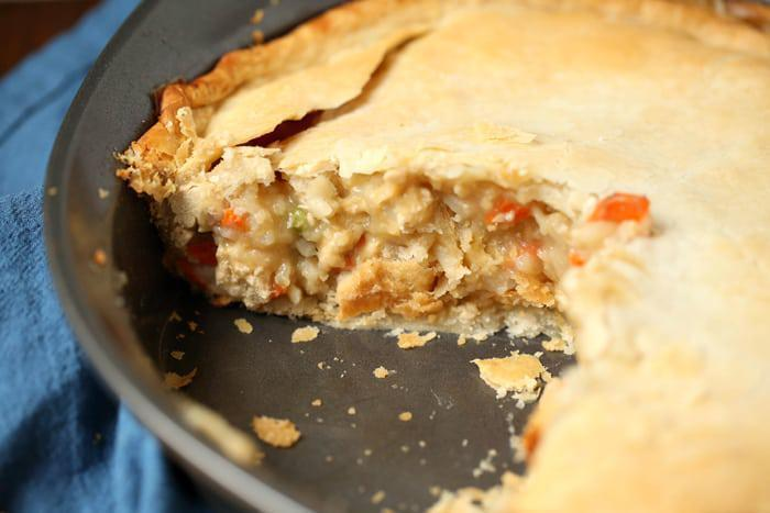 """<p>You may not associate chicken pot pie with summer, but it is and will always be an ultimate comfort food no matter the season. The hearty dish is bursting with chicken, potatoes, peas, carrots and onions tossed in a creamy filling. You can also save some time during prep by using <a href=""""https://www.thedailymeal.com/one-ingredient-makes-costco-rotisserie-chicken-addictive?referrer=yahoo&category=beauty_food&include_utm=1&utm_medium=referral&utm_source=yahoo&utm_campaign=feed"""" rel=""""nofollow noopener"""" target=""""_blank"""" data-ylk=""""slk:rotisserie chicken"""" class=""""link rapid-noclick-resp"""">rotisserie chicken</a> and mixing the shredded pieces right into the gravy.</p> <p><a href=""""https://www.thedailymeal.com/best-recipes/chicken-pot-pie-freezer-homecooked-meals?referrer=yahoo&category=beauty_food&include_utm=1&utm_medium=referral&utm_source=yahoo&utm_campaign=feed"""" rel=""""nofollow noopener"""" target=""""_blank"""" data-ylk=""""slk:For the Chicken Pot Pie recipe, click here."""" class=""""link rapid-noclick-resp"""">For the Chicken Pot Pie recipe, click here.</a></p>"""