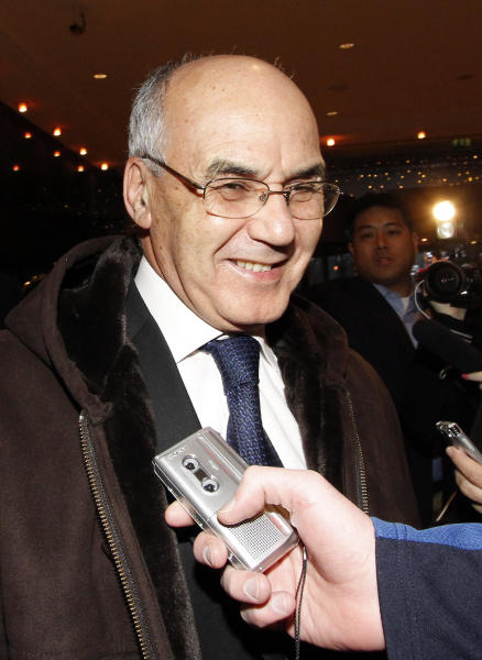Algeria's Minister of Energy and Mines Youcef Yousfi talks to journalists as he arrives at a hotel for a meeting of the Organization of the Petroleum Exporting countries, OPEC, in Vienna, Austria, Monday Dec. 10, 2012. (AP Photo/Ronald Zak)