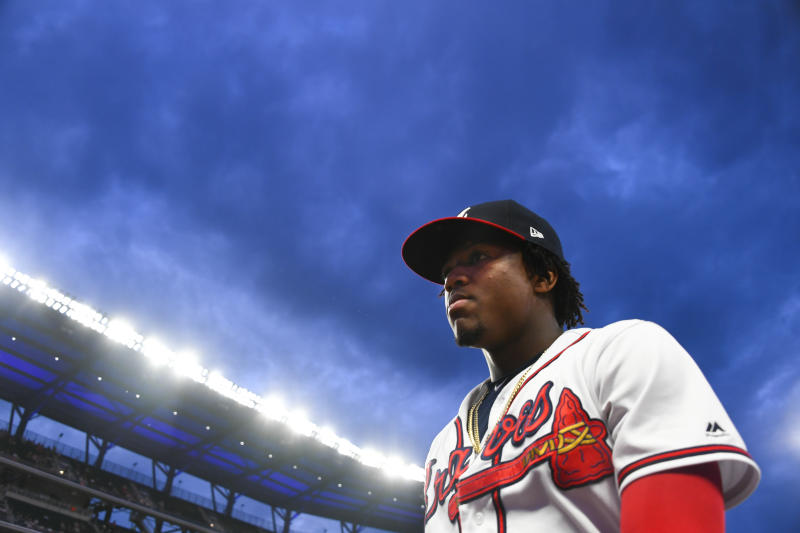 Atlanta Braves center fielder Ronald Acuna Jr. walks to the dugout before taking the field for a baseball game against the New York Mets, Wednesday, Aug. 14, 2019, in Atlanta. (AP Photo/John Amis)