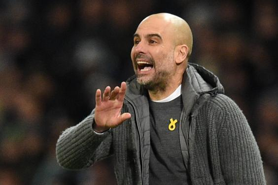 Pep Guardiola was charged last year for wearing as yellow ribbon (Getty)