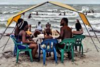 Haitian creole has become a common sound on the Necocli beach