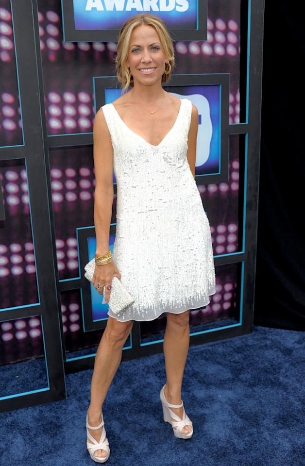 """Unfortunately, new mom Sheryl Crow's lovely lightened locks couldn't save this dull white dress and orthopedic platforms from flopping on the red carpet. Kevin Mazur/<a href=""""http://www.wireimage.com"""" target=""""new"""">WireImage.com</a> - June 9, 2010"""