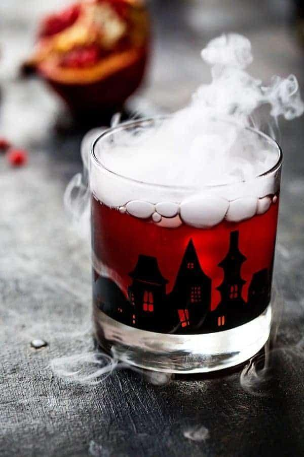 """<p>Talk about spooky! This pomegranate ginger punch will be sure to impress guests this season. </p><p><strong>Get the recipe at <a href=""""https://www.mybakingaddiction.com/pomegranate-ginger-punch/"""" rel=""""nofollow noopener"""" target=""""_blank"""" data-ylk=""""slk:My Baking Addiction"""" class=""""link rapid-noclick-resp"""">My Baking Addiction</a>.</strong></p><p><a class=""""link rapid-noclick-resp"""" href=""""https://go.redirectingat.com?id=74968X1596630&url=https%3A%2F%2Fwww.walmart.com%2Fip%2Fgoodcook-Stainless-Steel-Measuring-Cup-Set-4-Piece%2F45912114&sref=https%3A%2F%2Fwww.thepioneerwoman.com%2Fholidays-celebrations%2Fg36792938%2Fhalloween-punch-recipes%2F"""" rel=""""nofollow noopener"""" target=""""_blank"""" data-ylk=""""slk:SHOP MEASURING CUPS"""">SHOP MEASURING CUPS</a></p>"""