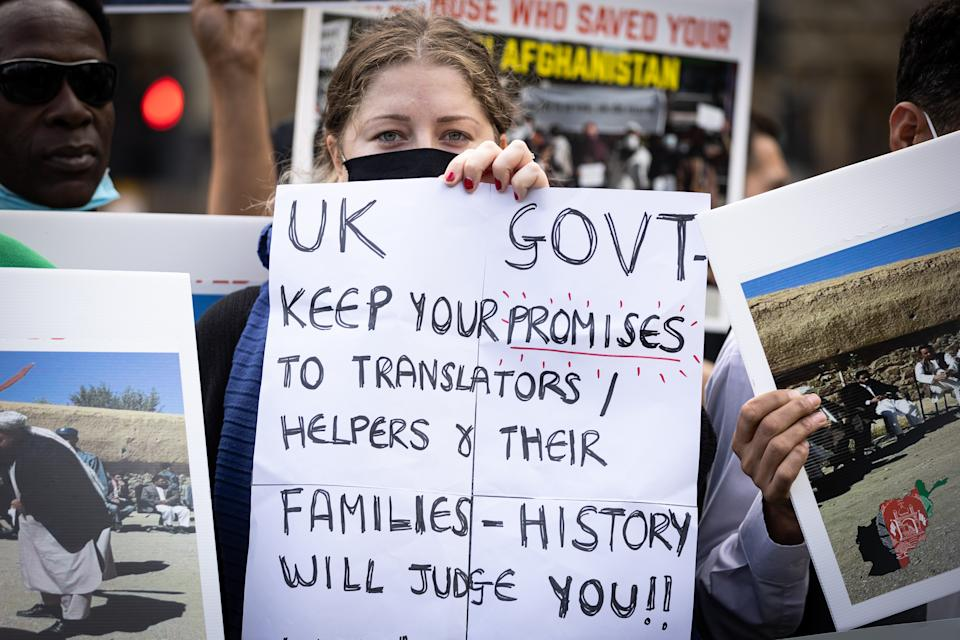 LONDON, UNITED KINGDOM - 2021/08/18: A protester holding a placard expressing her opinion, during the demonstration. Demonstrators including former interpreters for the British Army in Afghanistan protest in Parliament Square against Taliban and demand human rights in Afghanistan as MPs hold a debate on the crisis in Afghanistan in the House of Commons. (Photo by Tejas Sandhu/SOPA Images/LightRocket via Getty Images)