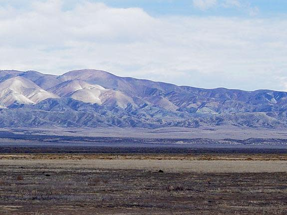 View looking east toward the Temblor Range in California's Coast Ranges. The trace of the San Andreas Fault is midway across the right side of the image about halfway across the valley.