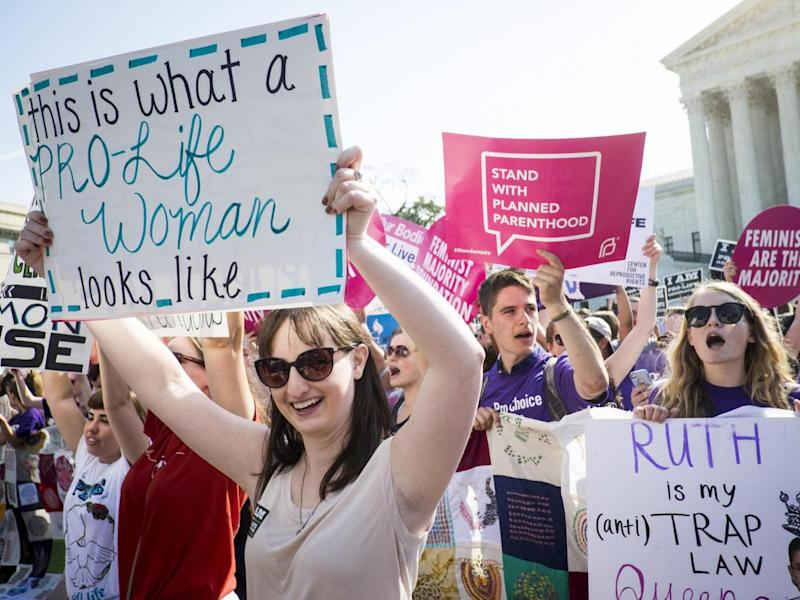 Pro-choice and anti-abortion activists demonstrate on the steps of the US Supreme Court: Getty Images