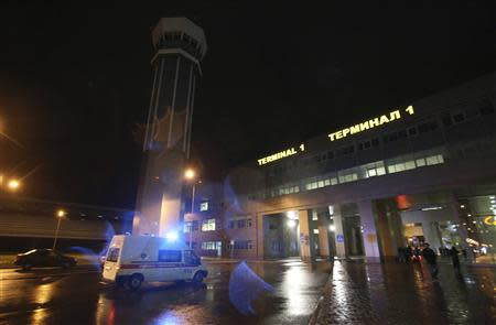 An ambulance is seen outside the main building of Kazan airport November 17, 2013. REUTERS/Yegor Aleev