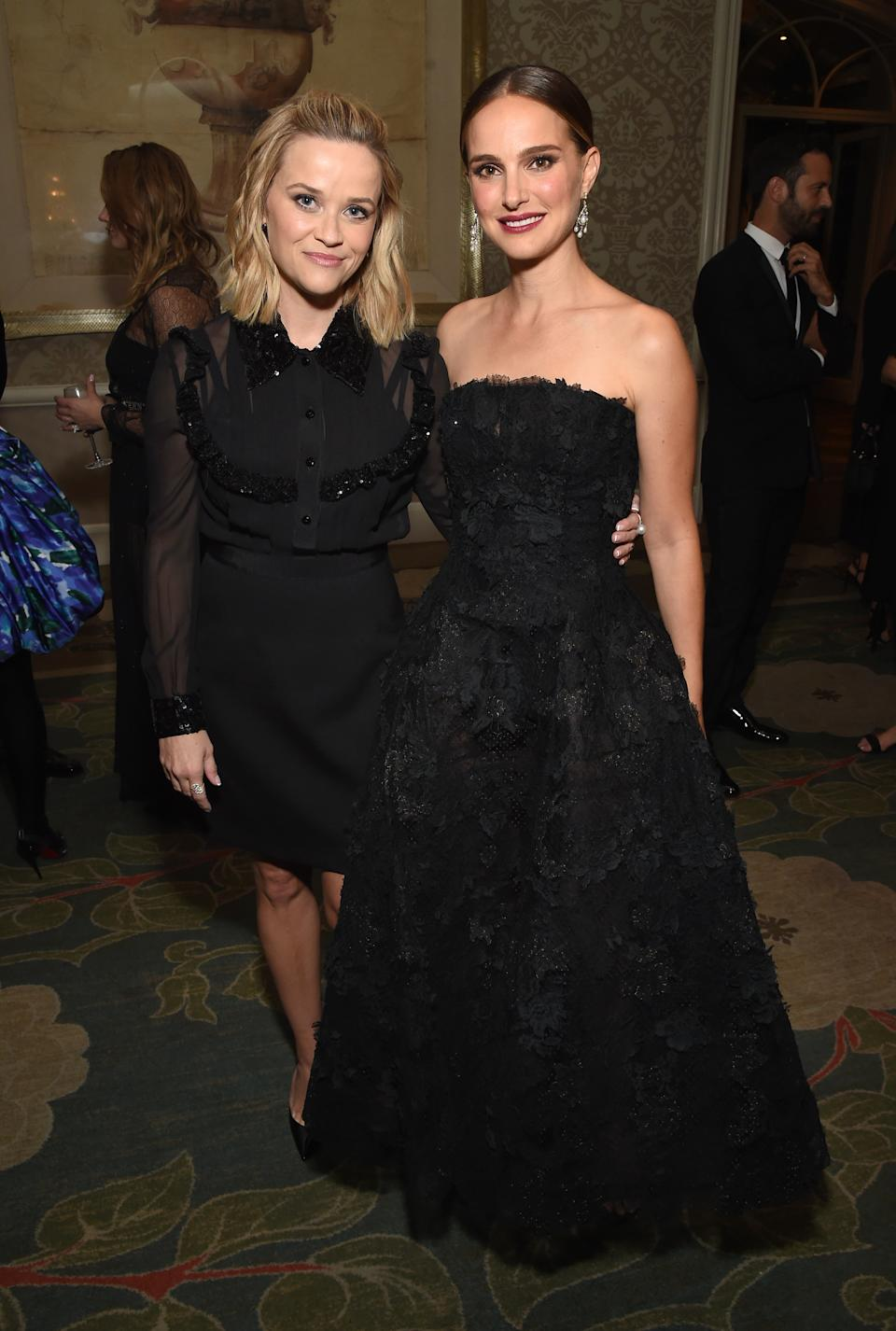 Reese Witherspoon wears a LBD while Natalie Portman wows in a strapless, black ballgown by Dior. <em>[Photo: Getty]</em>
