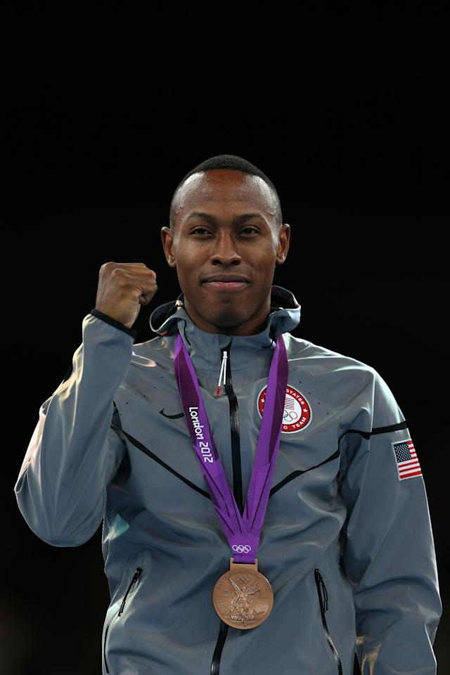 LONDON, ENGLAND - AUGUST 09:  Bronze medalist Terrence Jennings of the United States celebrates on the podium during the medal ceremony for the Men's-68kg Taekwondo on Day 13 of the London 2012 Olympic Games at ExCeL on August 9, 2012 in London, England.  (Photo by Hannah Johnston/Getty Images)