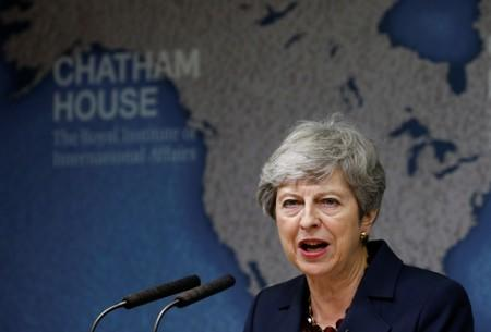 Criticizing populism, Britain's May has Brexit advice for successor
