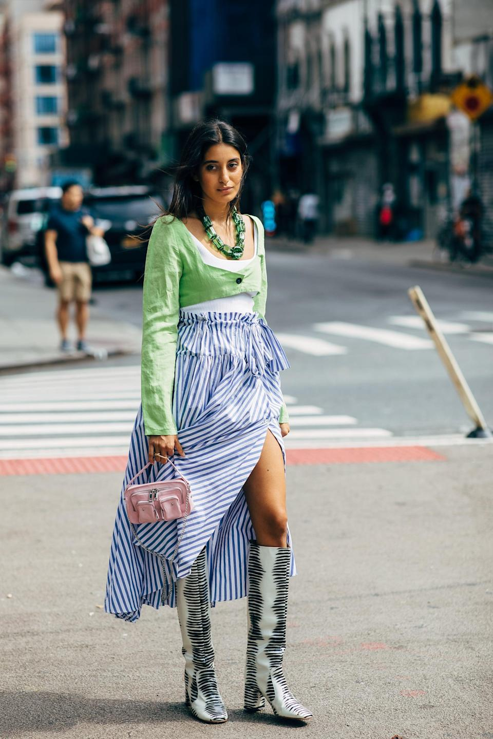<p>Take an inherently summery look, like blue and white stripes, and add boots to mix it up.</p>