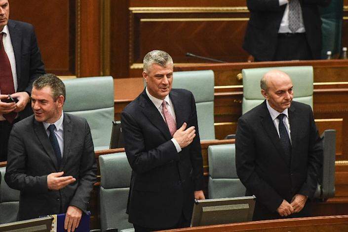 Newly elected President of Kosovo Hashim Thaci (C) reacts during an extraordinary session in Pristina on February 26, 2016 (AFP Photo/Armend Nimani)