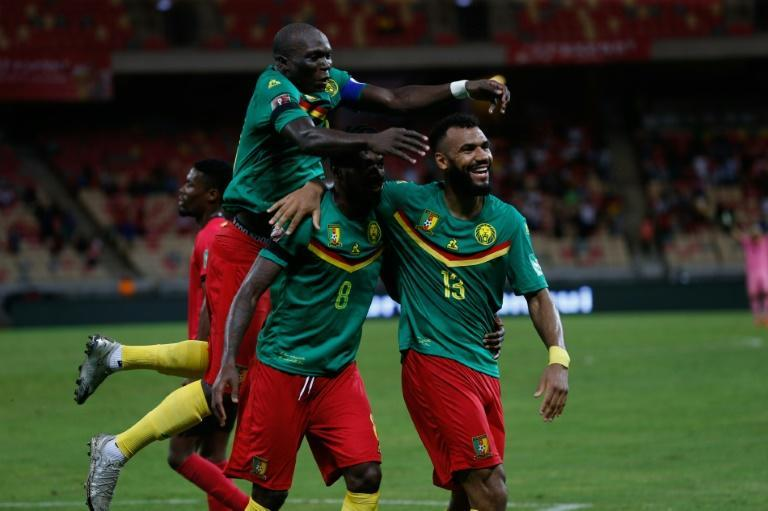 Eric Maxim Choupo-Moting (R) of Cameroon celebrates scoring against Mozambique in a World Cup qualifier in Douala on Friday. (AFP/Daniel BELOUMOU OLOMO)