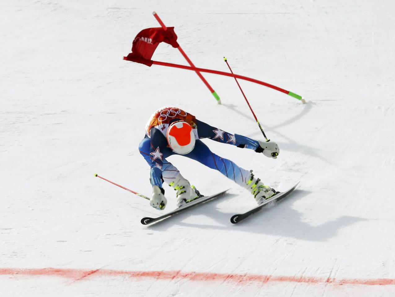 Bode Miller of the U.S. lunges towards the finish line during the first run of the men's alpine skiing giant slalom event in the Sochi 2014 Winter Olympics at the Rosa Khutor Alpine Center February 19, 2014. REUTERS/Mike Segar (RUSSIA - Tags: OLYMPICS SPORT SKIING TPX IMAGES OF THE DAY)