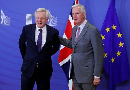 UK Secretary of State for Exiting the European Union Davis is welcomed by the European Commission's Chief Brexit Negotiator Barnier in Brussels