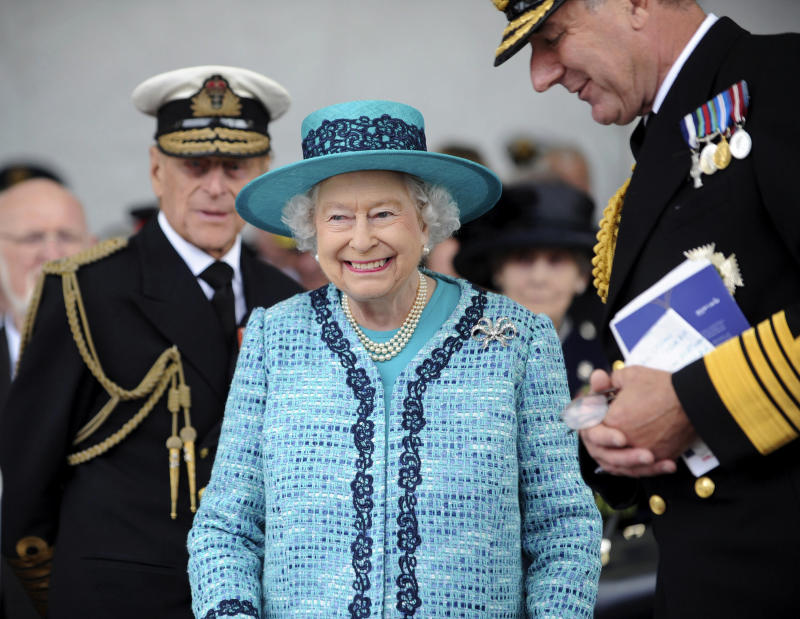 A Ministry of Defence handout picture shows Queen Elizabeth II and Prince Philip, The Duke of Edinburgh (L) at a ship-naming ceremony conducted at Rosyth Dockyard in Rosyth, Scotland on July 4, 2014