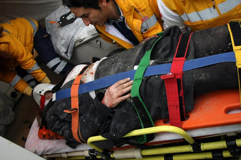 Medics and firefighters carry an injured woman on a stretcher to an ambulances after a suicide bomber had detonated an explosive device at the entrance of the U.S. Embassy in the Turkish capital, Ankara, Turkey, Friday, Feb. 1, 2013. A suspected suicide bomber detonated an explosive device at the entrance of the U.S. Embassy in the Turkish capital on Friday, killing himself and one other person, officials said. (AP Photo/Burhan Ozbilici)