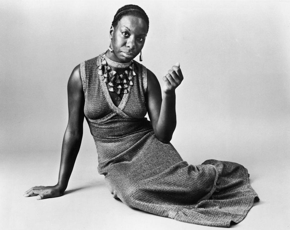 <p>Nina Simone put a spell on us with this easy knit dress and statement necklace. </p>