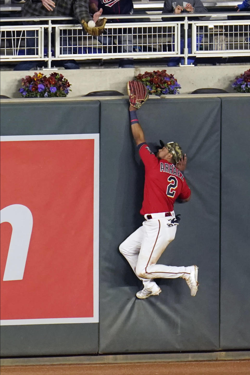 Minnesota Twins left fielder Luis Arraez cannot reach a fly ball off the bat of Oakland Athletics' Mark Canha for a solo home run in the eighth inning of a baseball game, Friday, May 14, 2021, in Minneapolis. (AP Photo/Jim Mone)