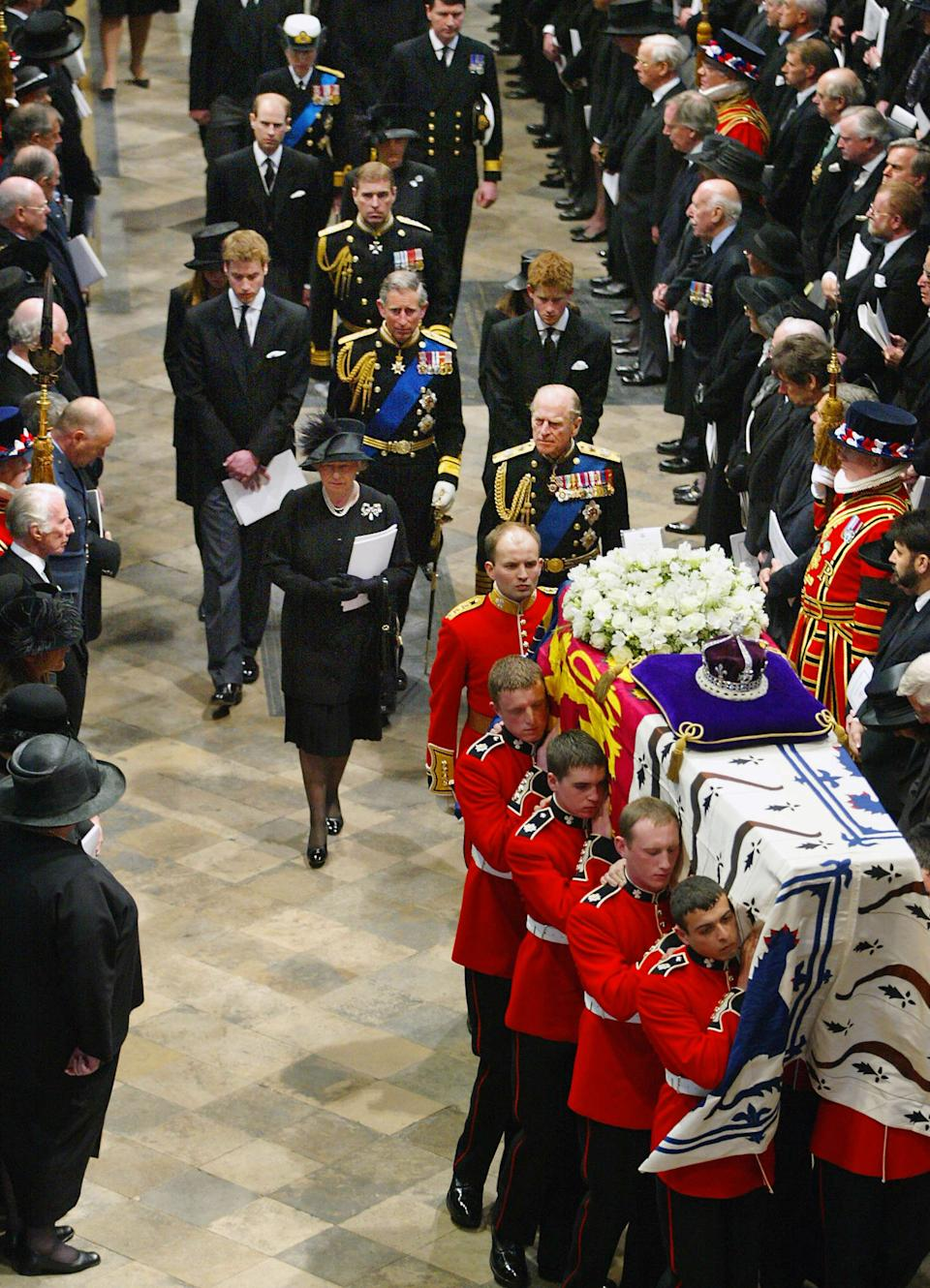 The British Royal Family follows the Queen Mother's coffin out of Westminster Abbey after the service in London 09 April 2002.