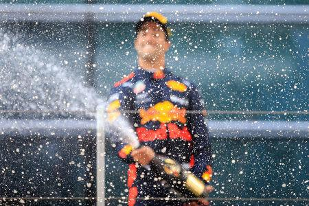 Formula One - F1 - Chinese Grand Prix - Shanghai, China - April 15, 2018 - Red Bull's Daniel Ricciardo celebrates with champagne after winning the race. REUTERS/Aly Song