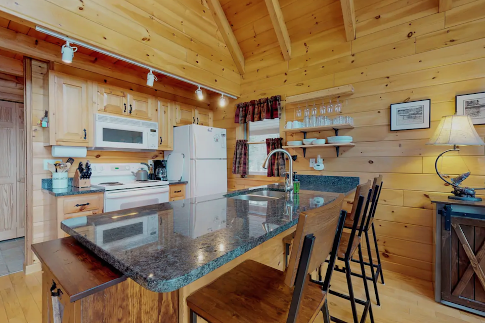 """<h2>Moosehead Lake, Maine</h2><br><strong>Location</strong>: Greenville, Maine<br><strong>Sleeps</strong>: 6<br><strong>Price Per Night</strong>: <a href=""""https://airbnb.pvxt.net/RyG4LN"""" rel=""""nofollow noopener"""" target=""""_blank"""" data-ylk=""""slk:$344"""" class=""""link rapid-noclick-resp"""">$344</a><br><br>""""This gorgeous home has all kinds of modern amenities and conveniences while maintaining the charming and cozy character of a rustic cabin. Inside, you can channel surf on the cable TV, cook a meal in the fully-equipped kitchen, or bust out the board games for a night of family fun. The massive wraparound deck offers stunning views of Lower Wilson Pond and the mountains beyond, which you can enjoy as you sunbathe or barbecue your dinner on the grill. When the sun sets, gather around the outdoor firepit for s'mores and stargazing.""""<br><br><h3>Book <a href=""""https://airbnb.pvxt.net/RyG4LN"""" rel=""""nofollow noopener"""" target=""""_blank"""" data-ylk=""""slk:Peaceful Lakefront Cabin"""" class=""""link rapid-noclick-resp"""">Peaceful Lakefront Cabin</a></h3>"""