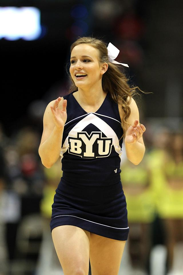 MILWAUKEE, WI - MARCH 20: A Brigham Young Cougars cheerleader performs during the second round game of the NCAA Basketball Tournament against the Oregon Ducks at BMO Harris Bradley Center on March 20, 2014 in Milwaukee, Wisconsin. (Photo by Mike McGinnis/Getty Images)