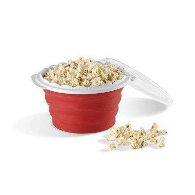 """<p><strong>Cuisinart</strong></p><p>target.com</p><p><strong>$12.99</strong></p><p><a href=""""https://www.target.com/p/cuisinart-red-microwave-popcorn-bowl-ctg-00-mpm/-/A-79729921"""" rel=""""nofollow noopener"""" target=""""_blank"""" data-ylk=""""slk:Shop Now"""" class=""""link rapid-noclick-resp"""">Shop Now</a></p><p>Homemade popcorn is leagues better than the pre-buttered, pre-bagged variety, but fussing with a pot of oil can be cumbersome. Enter this nifty silicone gadget from Cuisinart, which pops kernels in the microwave, functions as a serving bowl, and collapses for easy storage when not in use.</p>"""