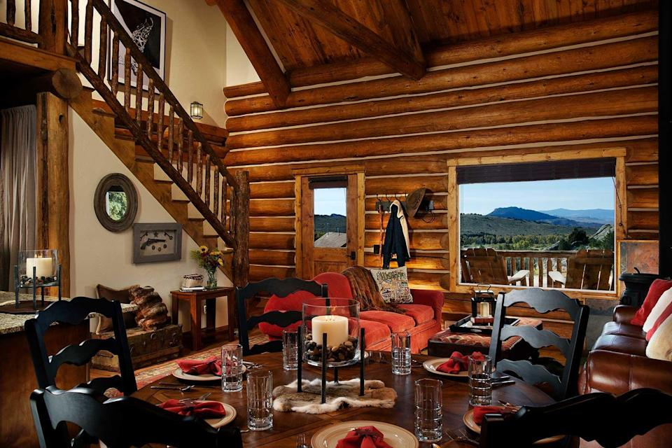 The dining area of a cabin at The Lodge & Spa at Brush Creek Ranch, voted one of the best hotels in the world