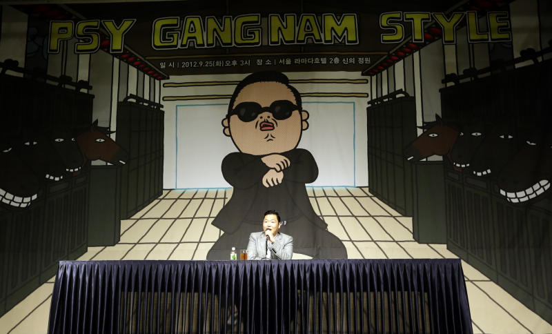 """South Korean rapper PSY, who sings the popular """"Gangnam Style"""" song, speaks to the media during a press conference in Seoul, South Korea, Tuesday, Sept. 25, 2012. (AP Photo/Lee Jin-man)"""