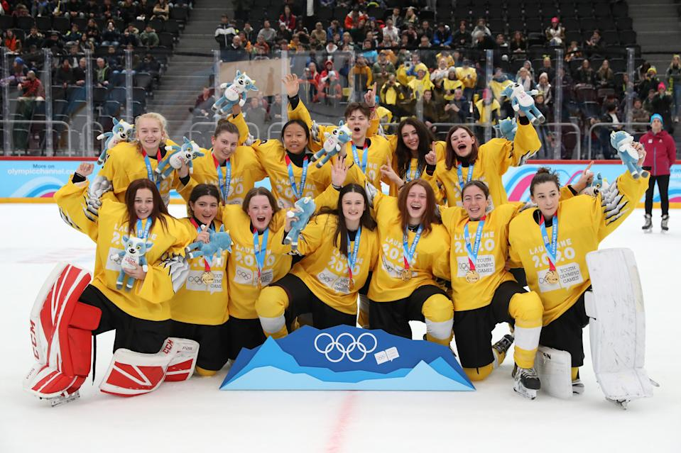 LES DIABLERETS, SWITZERLAND - JANUARY 15: Players of Team Yellow celebrate following their victory in their Women's Mixed Ice Hockey NOC 3-on-3 Finals Gold Medal match against Team Black during day 6 of the Lausanne 2020 Winter Youth Olympics at Vaudoise Arena on January 15, 2020 in Lausanne, Switzerland. (Photo by Linnea Rheborg/Getty Images)